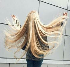 Girl fans out her long blonde hair