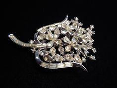 Trifari Floral Brooch.  Sparkling clear rhinestone pin by Trifari, set in silver toned metal.  Excellent condition. by LaytonandEverett on Etsy https://www.etsy.com/listing/228814689/trifari-floral-brooch-sparkling-clear