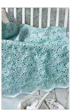 A mint green yarn makes the perfect baby blanket crochet pattern. The Little Encyclopedia of Baby Blankets
