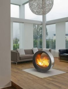 circular fireplace in middle of living room