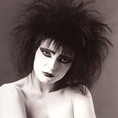 "Siouxsie Sioux photographed for the ""Through the Looking Glass"" album, 1987."