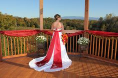 Lindsay was a gorgeous bride... she looked stunning! Her wedding was at Flower Mountain Weddings Sevierville, TN in the month of October. Her color was apple red by Davids Bridal. Photography by Casie Raines of Gatlinburg Photo.