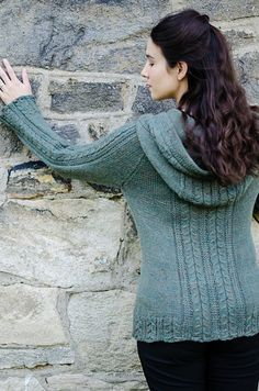 Lovely but simple cable and slipped stitch panels add a beautiful detail to this cozy hooded cardigan. The back and front panels travel up the hood for a unified design with an original yet easy to work construction. Sweater Knitting Patterns, Cardigan Pattern, Crochet Patterns, Hooded Cardigan, Knit Cardigan, Knit Sweaters, Alison Green, How To Purl Knit, Cardigans For Women