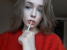 Smoking girl with beautiful blue eyes and brown hair. #beauty #cigarette #smoking #badass #fulllips #blueeyes #eyes