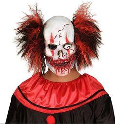 Masque latex clown sanglant adulte Halloween : Ce masque en latex est pour adulte.Il représente un clown sanglant avec des cheveux rouges et noirs et recouvrira les 3/4 de votre tête.Ce masque sera parfait pour terrifier vos...