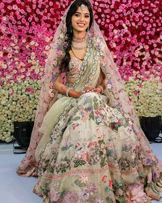 A pretty pastel lehenga with multicoloured floral embroidery all over paired with layered diamond jewellery - perfect for an intimate wedding. Don't miss the complementing flower studded ombré roses backdrop too! Designer - Rahul Mishra (C) Recall Pictures #intimatewedding #weddingideas #sweetandsimple #indianbride #brideandgroomphotos #indianweddinginspiration #bridaloutfit #bridalmakeup #bridallehenga #bridallook #wittyvows New Lehenga, Indian Bridal Lehenga, Lehenga Choli Online, Amritsar, Chandigarh, Bridal Outfits, Bridal Dresses, Lehenga Choli Images, Lehenga Color Combinations
