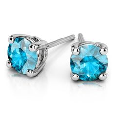 Aquamarine White Gold Diamond Stud Earrings. These alluring aquamarine studs feature two perfectly matching round cut aquamarine gemstones and are set in white gold four-prong settings. www.brilliance.co...