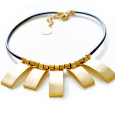 Catherine Nicole. Statement jewelry that make 'Made in the USA' ohhh so chic.