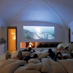 YESSS a giant bed and a big screen! Hello movie night!