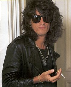 Joe Perry smoking a cigarette (or weed)
