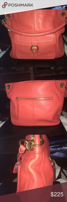 Coach Penelope Buckle Leather Hobo NWOT Gorgeous Tangerine color just in time for summer and will go into fall! 2 slip 1 zip pocket inside, 1 huge zip pocket on the back with another under the buckle flap in front with magnetic snap, gold tones with a few link accents at each end of the bag holding 1 handle, This beauty measures 14 X 12 X 3 MSRP $398 Coach Bags Shoulder Bags