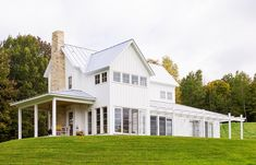 contemporary farmhouse - a blend of contemporary clean lines with classic farmhouse style, pitched roof and covered porch required! Often the exterior is vertical board and batten siding with stone or concrete mixed in for variety.