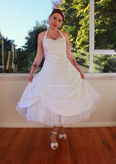 """1950s """"Cecilia"""" Pin up Wedding Dress with Sweetheart Neckline and Pearl Button Detail with Organza Petticoat - Custom Made To Fit. $305.00, via Etsy."""