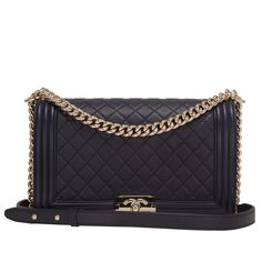 Chanel New Medium Boy bag of navy lambskin leather with light gold tone hardware. AVAILABLE NOW For purchase inquiries, Please Contact: Email: info@madisonavenuecouture.com I Call (212) 207-4572 I WhatsApp (917) 391-2281 Direct Message on Instagram: @madisonavenuecouture Guaranteed 100% Authentic   Worldwide Shipping   Bank Transfer or Credit Card