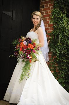 That cascading bouquet! Wowza!   Photo by http://www.johnpaulstudios.com/