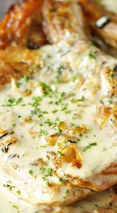 Slow Cooker Pork Chops with Creamy Herb Sauce.