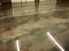 Metallic epoxy flooring gives concrete the rich depth and luster of marble. Metallic Marble Stain offers industrial strength of epoxy with metallic pigments Metallic Epoxy Floor, Acid Stained Concrete, Concrete Coatings, Floor Stain, Concrete Floors, Concrete Finishes, Epoxy Concrete, Plywood Floors, Concrete Lamp
