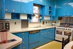 WOW  What a throw back to my Grandmother's metal cabinet-ed kitchen. Her's were off white, man did it hurt when your finger got slammed in one of those doors!