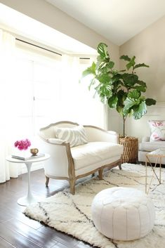 love this little white living room w/ the moroccan rug and saarenin side table