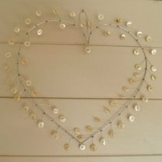 buttons and wire. Such a cute/pretty idea. Make a ton of these and hang them from your reception ceiling mixed with twinkle lights :)
