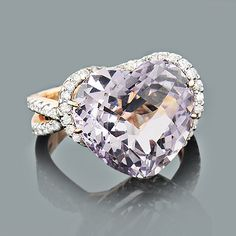 This Exquisite Heart Shaped Amethyst Ring with Diamonds in 14K rose gold weighs approximately 9 grams and showcases a fabulous 10.90-carat amethyst and 0.69 carats of sparkling round diamonds. Featuring a unique design and a highly polished gold finish, this ladies diamond cocktail ring is available in 14K white, yellow and rose gold. #ItsHotdotcom