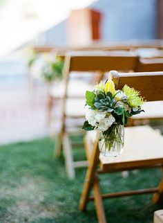 flowers in mason jar for aisle decor