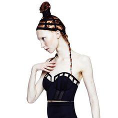 The Chromat Extended Bustier: Black neoprene with black corset boning, mesh and back zip.