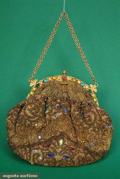 Jeweled Gold Boullion Evening Bag, 1920s, Demi-lune brass frame w/ multicolored jewels on frame & bag, gold soutache braid & gold lace (somewhat tarnished, some losses to jewels), good, purple satin lining excellent. Description by Augusta Auctions.