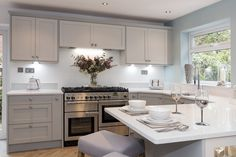 The goal of this kitchen design was to add light to the previously dark and gloomy kitchen. With light pebble grey and dove grey paint and a luxurious quartz strata worktop in white mirror effect really brightened reflecting the overhead spotlights. Kitchen Fittings, Open Plan Kitchen Dining, Kitchen Inspiration Design, Howdens Kitchens, Grey Kitchen Designs, Small Kitchen, Kitchen Plans, Grey Shaker Kitchen, Kitchen