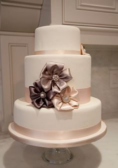 Ribbon flowers on a white cake. So pretty.