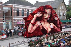 According to the parade organizers, floats such as this striking red-haired…