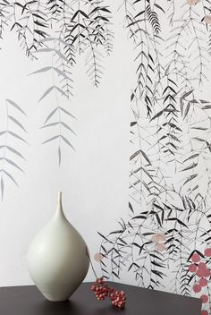 This Wallpaper ANACA is handprinted by Susanne Thurn.  Elegant branches in grey and black, dots in red and rose.