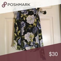 """Floral American Apparel skirt Hits right above the knee and is a loose material. Ties on the side. Worn only once! Size is a """"M/L"""" Skirts Midi"""