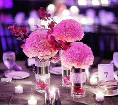 Love this! I never thought hot pink with rhinestones could ever look sophisticated, and here it does. Pink carnation clusters, orchid sprigs, and simple glass cylinders and votives with rhinestone cuffs on a platinum tablecloth - incredible!