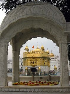 The Harmandir Sahib seen through an archway. (Amritsar) :) - golden temple