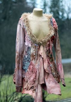 Tribal- inspired shabby chic bohemian jacket is made of cotton jersey and has asymmetric waterfall hems- at one side longer than another. It has