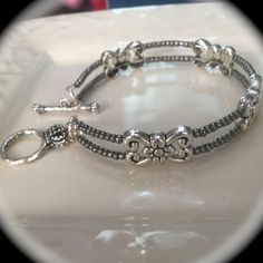 All jewelry is handcrafted with glass beads and silver plated accents. - Bracelets are made with easy stretch material so they will fit all wrist sizes comfortably.