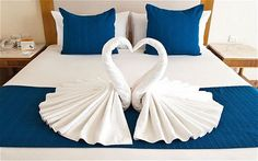 Bath towels folded to look like swans!