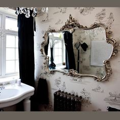 Gorgeous. The mirror, the toile wallpaper, the antique details... perfect!