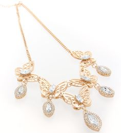 An exclusive, one-of-a-kind soft gold plated statement butterfly-inspired necklace.