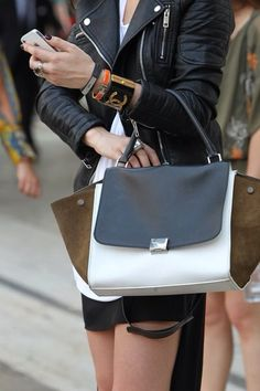 This girls hasn't missed one fashion trend: dark Nail polish, ring, bracelets/cuffs, leather jacket, the bag, and short skirt, don't forget the iPhone. TheyAllHateUs