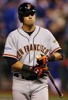 KANSAS CITY, MO - OCTOBER 29: Joe Panik #12 of the San Francisco Giants reacts after striking out in the third inning against the Kansas City Royals during Game Seven of the 2014 World Series at Kauffman Stadium on October 29, 2014 in Kansas City, Missouri. (Photo by Elsa/Getty Images)