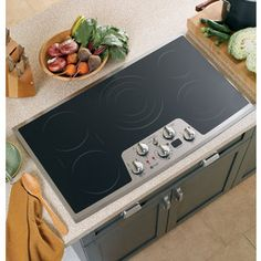 GE�Profile 36-in Smooth Surface Electric Cooktop (Stainless Steel) 829.00 stainless around rim