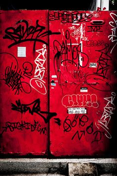 """Graffiti: Graffiti on the red old doors."" by olliwang (Olli Wang)"