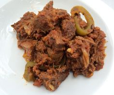 """Literally translated as """"old clothes,"""" ropa vieja is shredded beef with peppers and this version is gluten free and paleo-friendly."""