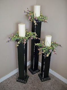 DIY floorstanding candlesticks. toppers from Hobby Lobby for a buck each, plus a 4x4, for a total around $12 for the 3 (plus paint and hardware).