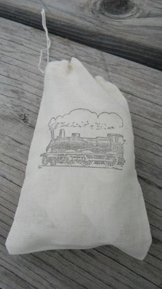 Set of 10  Hand stamped Train Kids Party Muslin Gift Party Favor Bags 100% organic made in america. $12.00, via Etsy.