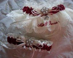Stunning Ivory and Burgundy/Wine keepsake and toss wedding garter set. Satin, lace, organza, embroidery, rhinestones and pearls gave the bride every design element she envisioned. Garter Style 10 customized and Style 5 (toss).