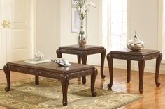 """San Martin by Ashley  Cocktail table and two end tables  Made with select Birch veneers  Medium brown finish    3pc Set $399.00     Cocktail: 51""""W 27""""D 18""""H  End: 23""""W 22""""D 24""""H   OAK T593-13"""