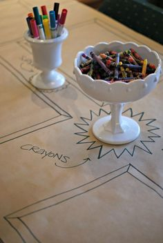 I want to have small tables with crayons like this for kids to sit at at my wedding. Brown paper table cloth with frames drawn for crayon artworks. Dimples and Tangles